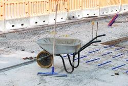 Abandoned wheelbarrow in city road reconstruction project