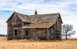 Abandoned wooden house in field. Abandoned farm house view. Abandoned house in field. Abandoned wooden house view