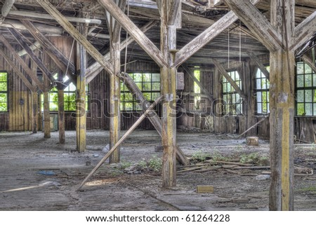 Abandoned wooden industrial building with broken windows
