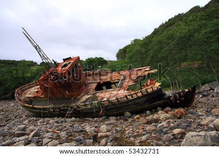 Abandoned wrecked fishing trawler beached on the shore