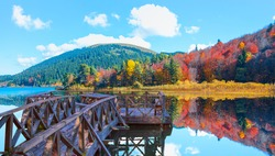 Abant Lake - Autumn forest landscape reflection on the water with wooden pier - Abant National Park - Bolu, Turkey