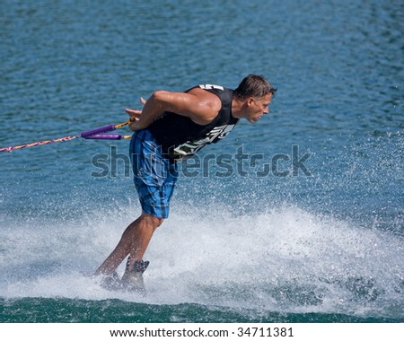 ABBOTSFORD, BC - AUGUST 3: Corey Walters from the Surrey Fire & Rescue Dept competes in the waterskiing trick event at the World Police and Fire games Aug 3, 2009 in Abbotsford, BC.