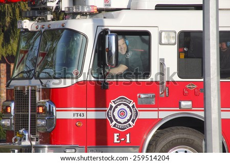ABBOTSFORD, BC/CANADA: MARCH 9, 2015: First responders from the Abbotsford fire and rescue service on their way to a fire at the airport on March 9, 2015.