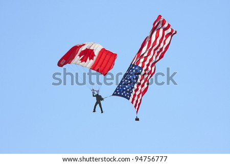 ABBOTSFORD, CANADA - AUGUST 14:  Canadian Skydivers perform aerial maneuvers over the skies at the Abbotsford International Airshow on August 14, 2010 in Abbotsford, Canada - stock photo