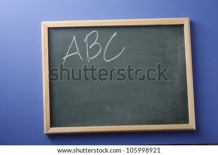 ABC printed in chalk on blackboard
