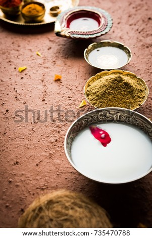 Abhyanga Snan OR Special Herbal Bath on Diwali with Ubtan or Utne and Scrub over moody background, selective focus
