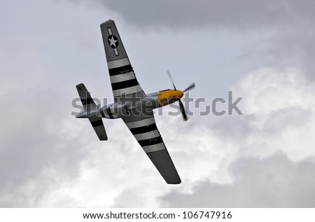 ABINGDON UK MAY 6 A veteran WW2 P51 Mustang fighter aircraft gives an aerobatic display in stormy skies for the watching public at the Abingdon airshow on May 6 2012 at Abingdon