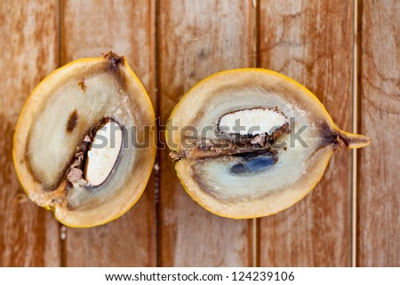 Abiu Fruit cut in half on wooden table