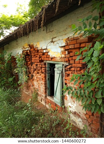 Abondoned house with bricks falling out #1440600272