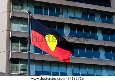 Aboriginal flag in front of a modern Australian building