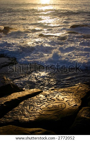 Aboriginal pattern carved in rock at Bondi Beach, Sydney, Australia.