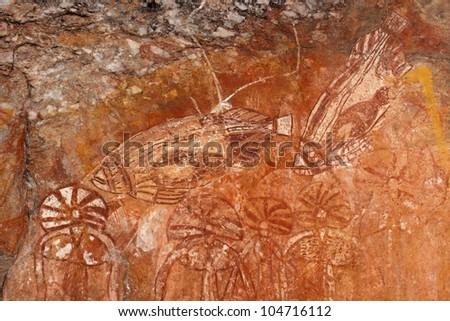Aboriginal rock art depicting fishes, Nourlangie, Kakadu National Park, Northern Territory, Australia - stock photo