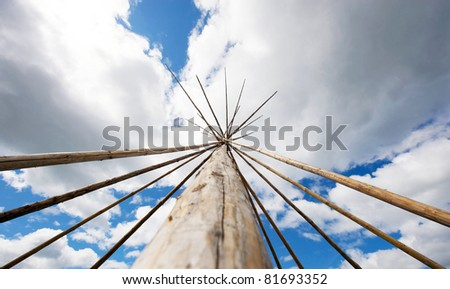 Aboriginal teepee frame made from very tall sticks.  Wide angle.