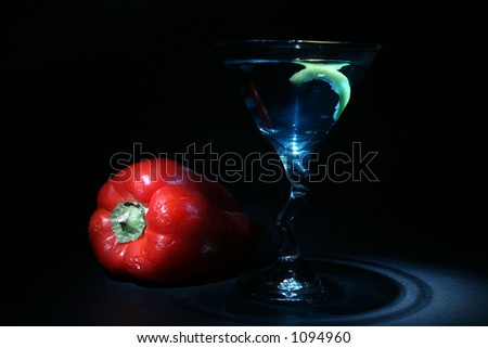 about 2 seconds time laps (on each item individually) aka bulb exposure still life of a martini with lemon twist a red bell pepper with green stem on black light up with a small flashlight