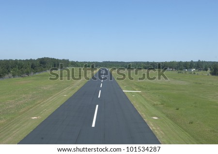 Above a small runway on take off.