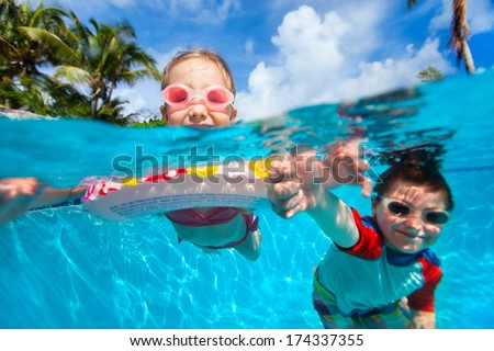 Above and underwater photo of kids swimming in pool