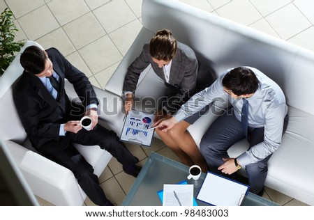 Above angle of business group discussing papers