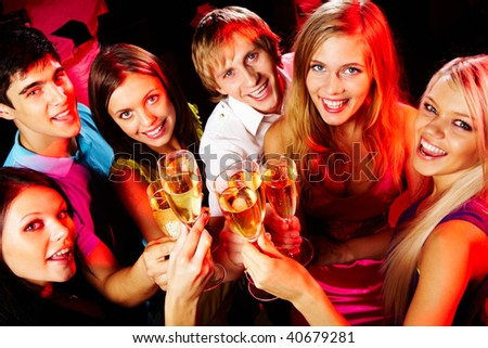 Above angle of group of friends enjoying themselves at party