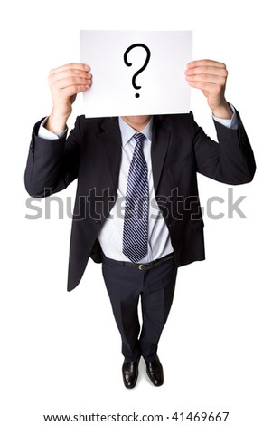 Above angle of smart businessman in suit showing paper with question mark on it