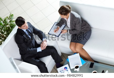 Above angle of two business partners discussing working plans