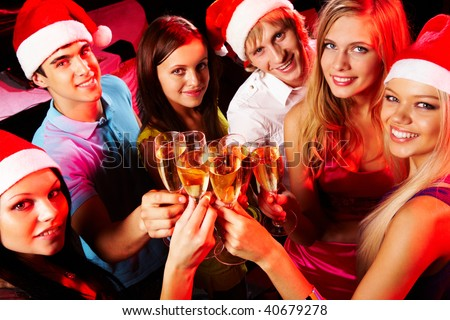 Above angle of young people enjoying themselves at Christmas party