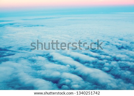 Above clouds, pastel color sky. Dawn sky from plane #1340251742