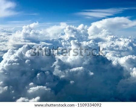Above cumulonimbus clouds