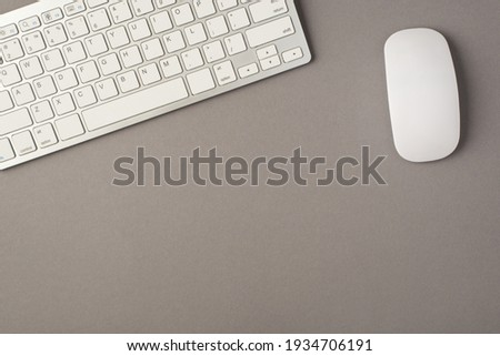 Above photo of keyboard and computer mouse isolated on the grey background with empty space