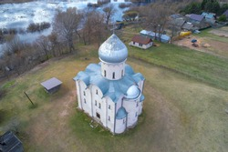 Above the ancient Church of the Transfiguration of Our Savior on Nereditsa on a spring day. Veliky Novgorod, Russia