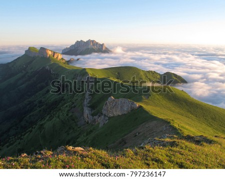 Above the clouds in the mountains, Mount Big Thach, Caucasus, Russia