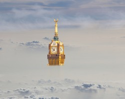 Above the clouds view of Abraj Al Bait Makkah Tower, (Royal Clock Tower Mecca) and dry mountains of holy city Saudi Arabia