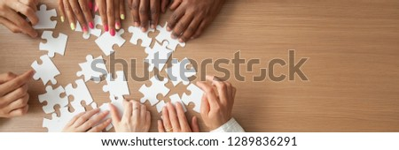 Above top panorama copyspace for text diverse hands people assemble jigsaw puzzle put pieces together search common decision. Support teamwork concept horizontal photo banner for website header design