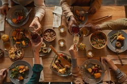 Above view background of multi-ethnic group of people enjoying feast during dinner party with friends and family