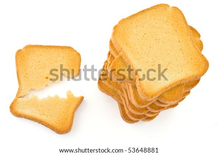 Above view of a broken rusk and a pile of rusk; isolated on white background