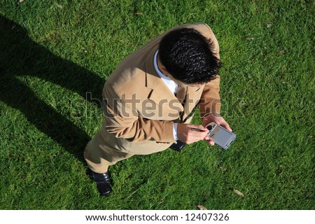 Above view of a businessman looking to his pocket pc