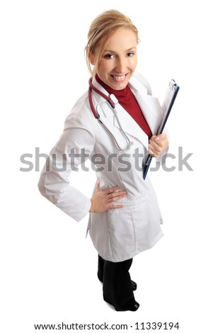 Above view of a smiling bright confident female doctor (or nurse) standing and holding folder of medical paperwork.