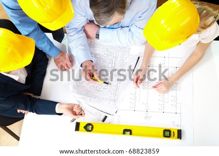 Above view of architects planning a house project