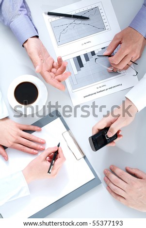 Above view of business people hands working with documents at briefing
