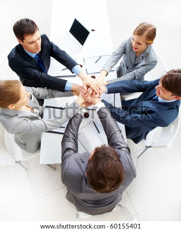 Above view of business people with their hands on top of each other