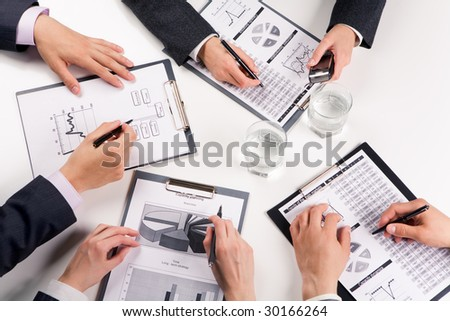 Above view of business people working with documents at training - stock photo