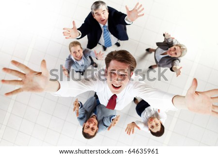 Above view of happy chief being thrown by several partners upwards