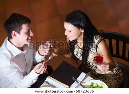 Above view of happy couple eating at dinner