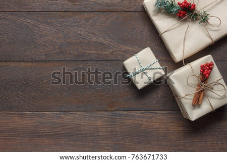 Photo of Above view of image item Merry Christmas & Happy New Year decor festival background concept.free space for creative design.Essential decorations on modern rustic brown wood at home office desk studio.