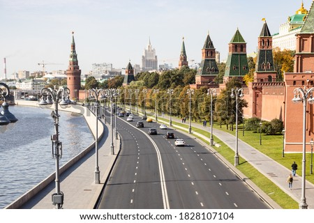 above view of Kremlin Embankment and Kremlin Towers along Moskva River in Moscow city from Bolshoy Moskvoretsky Bridge on sunny autumn day Stock photo ©