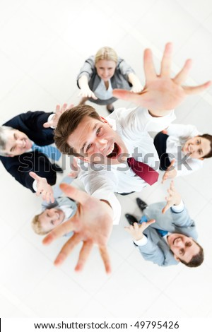 Above view of several successful partners throwing new ceo upwards