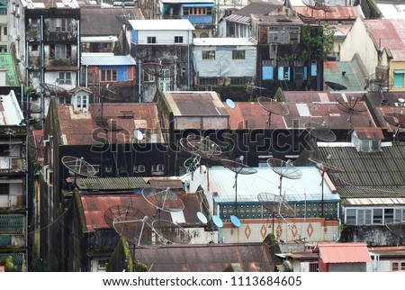 Above view of the rooftops of the old low rise houses and apartment buildings in the center of Yangon city, Myanmar. stock photo