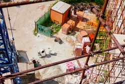 Above view on construction site area, piled resources for building edifice.