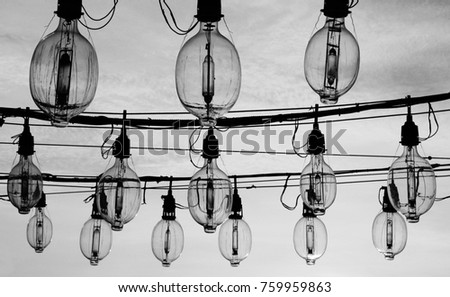 Shutterstock above water fishing lamp on fishing boat under sunset. black and white