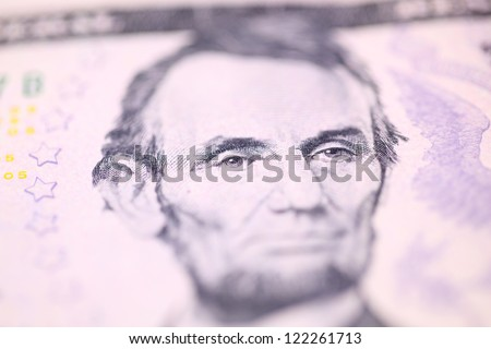 Abraham Lincoln, the 16th President of the United States, on five dollars bill.