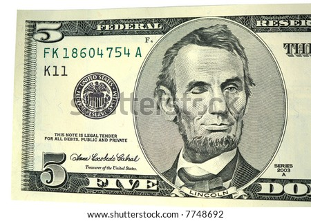 Abraham Lincoln winking on five dollar bill isolated on white
